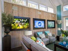 HGTV Smart Home 2013 Living Room: Pickled pecky cypress houses three flat-screen TVs, programmable via the home's smart tablets. http://www.hgtv.com/smart-home/hgtv-smart-home-2013-living-room-pictures/pictures/page-9.html?soc=pinterest