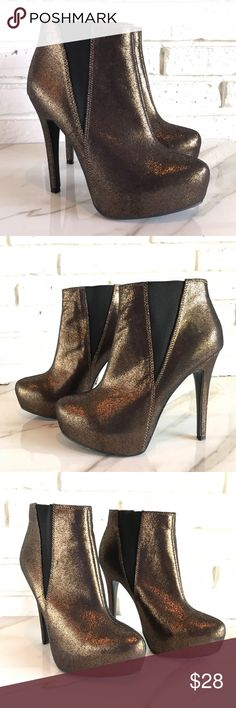 Bronze Metallic Ankle Boots Rock & Republic Sexy Sexy platform ankle boots by Rock & Republic size 6.5 in very nice condition. Pull on with elastic on the sides. A great rock and roll look. Bronze distressed look Rock & Republic Shoes Ankle Boots & Booties