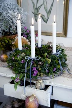 Christmas wreath centerpiece - would make a pretty Advent Wreath. Substitute white candles with 3 purple, 1 pink and a pillar white in the center. Purple Christmas, Noel Christmas, Winter Christmas, All Things Christmas, Christmas Wreaths, Advent Wreaths, Christmas Table Centerpieces, Xmas Decorations, Deco Floral