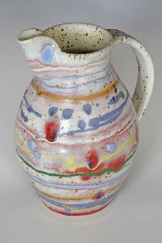 Potter I just found.  Chris Barnes.  LOVE his colorful work.