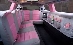 Pink and grey leather limousine interior with mother of pearl bar