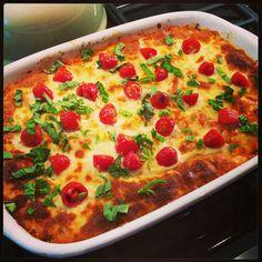 Creamy Caprese Quinoa Bake Recipe Main Dishes with cooked quinoa, pasta sauce, tomato paste, heavy cream, parmesan cheese, mozzarella cheese, grape tomatoes, fresh basil, crushed red pepper, salt, pepper