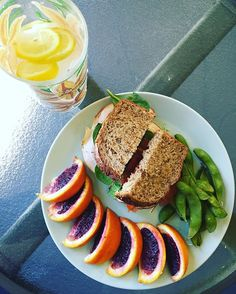 Lunch was quite fantastic. Turkey and pepper jack cheese on sprouted rye bread with edamame and blood oranges. Enjoying it outside on this lovely #edamame #traderjoes #fresh #healthy