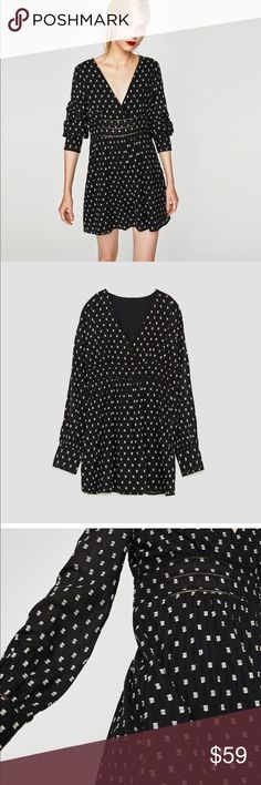ZARA BLACK & WHITE V NECK MINI DRESS Zara Black And white v neck mini dress. With almost a polka dot look to it. Has small embroidered squares dotted all over it. Has small eyelet cut outs along the small of the waist. Has long sleeves. V neck. Lightweight.   Brand new with tags. Size small. Zara Dresses Mini