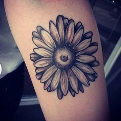 Beautiful gerbera daisy! Done by apprentice Bridget Stoltz (instagram @bridgetstoltz) at Blaque Owl Tattoo (instagram @blaqueowltattoo)