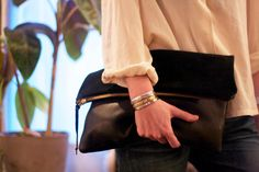 NEW Large Portfolio Clutch in Black Leather by BtwnWindandWater, $115.00. Bought.  The bag isn't as large as it appears to be in the photo.