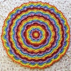 The Flower Puddles & Ripples Blanket is a highly textured, cabled blanket that is worked in rounds.