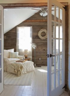 painted white floor with a rustic back wall to add dimension…wonder what they used for the flooring