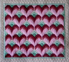 Stitch a Valentine decor piece for your home, or as a gift. The project works up quickly in long stitch, with a touch of Hungarian stitch around the borders. A matching medallion pattern is also included.