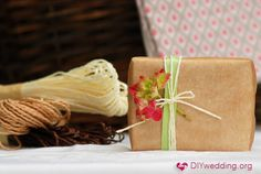 Wrapping wedding favors in brown baking paper.... love the vintage look