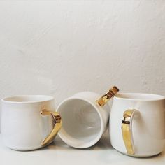 Each mug is handmade, wheelthrown, glazed and fired with a final gold lustre firing which is gold. we only use food safe glazes. These are recommended hand wash to maintain the gold lustre. Porcelain Mugs, Napkin Rings, Wedding Gifts, My Etsy Shop, Handle, Tableware, Gold, Gift Ideas, Architecture