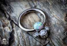 titanium captive ring with gemmed cluster bead
