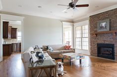 Family Room with Behr Sculptor Clay and Silky White Trim-Stone for fireplace, with similar mantle.
