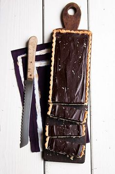 lavender-honey dark chocolate tart with a cardamom-lemon crust