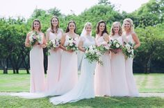 Beautiful pastel pink long bridesmaids dresses at this stunning Bancroft Hall wedding in Somerset.