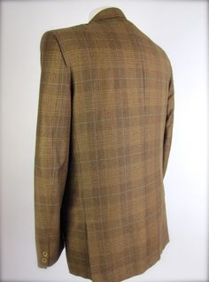 A fine Vintage 60's Mens Sporty Suit Jacket By Lord Shelby  This is a fab mens suit coat jacket from the 1960's.  Classic light wight wool and rayon mix that has the look of sharkskin.  Golden olive green subtle plaid pattern with a slight sheen to it.  Slim lapels with two button closures at the front and two matching at each sleeve.  Three flat functional pockets at the chest and lower front.