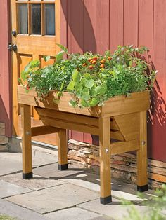 Place the Wallhugger VegTrug™ along a fence or wall to create a tidy and convenient vegetable growing area in a very small space. It's deeper at the back for large plants like tomatoes, and shallower in front for greens, herbs and other small plants. Raised Garden Planters, Raised Garden Beds, Raised Beds, Trough Planters, Tall Planters, Wooden Planters, Planting Vegetables, Growing Vegetables, Vegetable Gardening