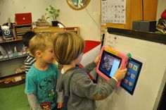 Children using QR codes to access e-books.