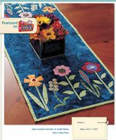 """Easy fused flowers and colorful buttons adorn this cute table runner. Quilt designed by Jodie Davis and is 14 1/2"""" x 38 1/2"""". Only $5 for the digital pattern."""