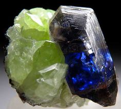 Tanzanite crystal on green Diopside crystals / Merelani Hills, Lelatema Mtns.,Tanzania