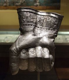 Hittite Drinking vessel. Near Eastern, Anatolian, Hittite, Hittite New Kingdom, reign of Tudhaliya III, 14th century BC. This ceremonial drinking vessel is shaped in the form of a human fist with a procession of musicians in relief along the cuff. Currently located at the Boston Museum of Fine Arts.