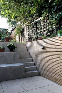 Milton - New external terrace area with cast concrete steps leading to garden.