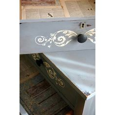 The Artisan Enhancements Floral Scroll stencil was used to create unique designs on these dresser drawer fronts.