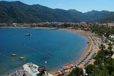 Aegean Sea meets the Mediterranean, the stunning   beach resort of European taste, with luxury yachts in the bay.