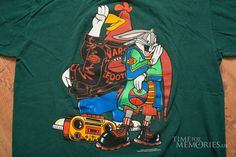 For sale here is a vintage 90s Looney Tuneship hopshirt featuring Foghorn Leghorn and Bugs Bunny; made in USA.