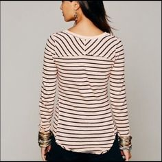Adorable Free People crochet sleeve tee, XS Worn once - Free people crochet sleeve tee. So cute! Size XS. Pink with burgundy stripes. Lovely detailing on sleeve. Free People Tops