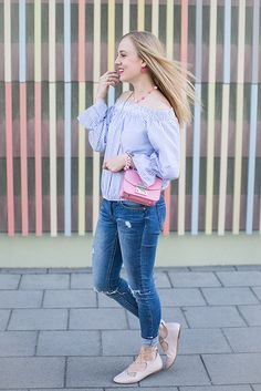 Off the shoulder blouse with mini bell sleeves and a pink pop
