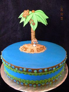 Monkey Boy theme - Buttercream with fondant ribbon around. The cake was made to match the monkey boy theme invitations and the palm tree was a replica of the centerpieces for the baby shower. Palm tree made out of gumpaste.