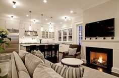 Open kitchen and living area, white cabinets
