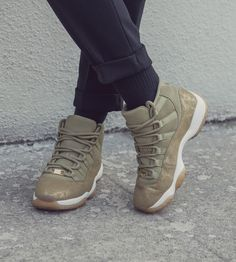 98b8fea63446a9 Women s Air Jordan 11  Neutral Olive   Sail   Gum Light Brown  Release Date