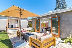 4215 LYCEUM AVE, LOS ANGELES, CA 90066 3 BR + 2 BA  |  $1,478,000 Agent: Susan Williams  This updated contemporary home boasts a newly remodeled garage outfitted with skylights and french doors that open up to the backyard, offering the perfect setting for indoor/outdoor entertainment with a dining table, mounted television, fire pit, and grassy area.