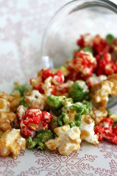 Christmas Caramel Popcorn  3 bags butters and salted popcorn, popped (remove any kernels) unpopped 3/4 cup butter 1 1/2 cups brown sugar 1/4 + 1/8 cup light corn syrup 1/4 + 1/8 teaspoons baking soda 1 teaspoon vanilla extract red and green food coloring