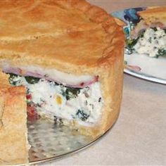 Torta Rustica. I make a version of this every Easter, using prosciutto, sausage, lots if spinach and home charred red peppers. I add garlic to the cheese mixture... It's a thing of beauty when complete