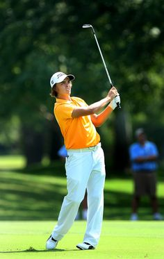 Rickie Fowler watches his shot in the fairway at No. 12 during Wednesday's round of 64 at Southern Hills Country Club.