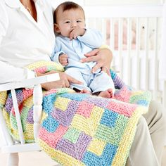 Pastel tones in silky homespun yarn give this easy baby afghan a quilted look.