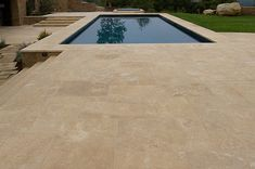 Coeur d' Alene Dark Limestone Sawn Edge Paving and Pool Coping - Pompadour Finish