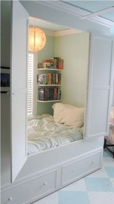 Reading nook in a built-in cabinet! How wonderful to curl up in here on a yucky day…or just to hide with a good  book or a laptop. And no one would be the wiser. :)