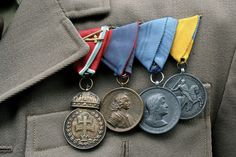 Hungary. The medals from left to right are the Signum Laudis medal with war ribbon and swords, the Commemorative Medal for the Liberation of Upper Hungary, the Commemorative Medal for the Liberation of Transylvania and the Commemorative Medal for the Return of South Hungary.