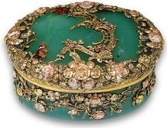 This oval snuffbox is made from chrysoprase, a green variety of quartz that was used extensively in Europe until the middle of the last century. he design is probably by Jean Guillaume George Kruger, a London-trained designer who moved to Berlin in 1753 and designed a series of snuffboxes in the Prussian royal collection. This particular box dates from around 1755. Today, most of the world's supply of chrysoprase comes from Australia.