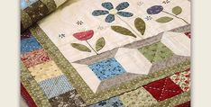 Mix and Match Beautiful Fabrics from Your Stash! Scrappy spool blocks and a simple pieced border are made even more charming with sweet appliqued flowers. The combination finishes into a beautiful table runner to enjoy on any flat surface in your home. Hand-turned applique and hand quilting will make this runner extra special. However, you …