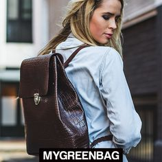 An original design with versatile uses. Shop the crocodile print backpacks at http://mygreenbag.co.uk/brown-leather-backpacks.php#!/The-Crocodile-Print-Backpack-Brown/p/47994083/category=11363053 MGBxx