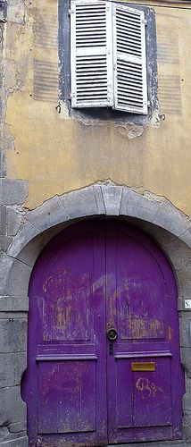 A secret vintage lavender door.  France, Auvergne, Clermont-Ferrand