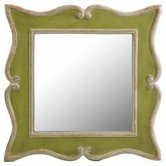 Wall mirror with a weathered scrolling frame.  Product: Wall mirrorConstruction Material: MDF and mirrored glassColor: Olive Features:  Whimsical frame shapeWorn finish Dimensions: 23.5 H x 23.5 W x 1.25 D