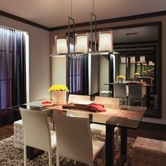 Big makes a bold statement. This over-sized linear chandelier (Kichler 42548CLP) matches the length of the table and adds a slick touch to the dècor of this modern dining room.