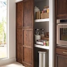 I love this option for pantry doors. With a little creativity your the pantry door can be the same cabinetry as your kitchen. Using the face frame and tall pantry doors assembled on a closet track you'll have a beautiful sliding pantry door. No more white bifolds. #kitchensByCHIGeorge #kitchen #kitchenremodel #classichomeimprovements #homeremodeling #georgebrown711 #sandiegokitchens