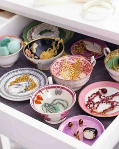 Orphaned teacups and saucers are perfect vessels for sorting jewelry!